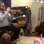 Trumpeter Eric Siereveld demonstrating jazz rhythms for students at Huegel Elementary